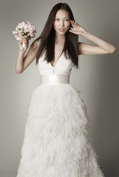 Wedding dress with detachable feather skirt