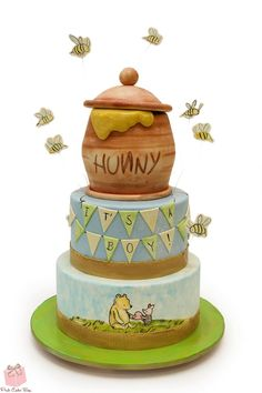 This Cute Winnie The Pooh Baby Cake was made by Pink Cake Box. The top layer of the cake is Pooh's brown Hunny pot with Hunny overflowing out of it. Bees are flying around the Hunny Pot. The middle layer of the cake is light blue with a banner that. Baby Cakes, Baby Shower Cakes, Baby Shower Themes, Baby Boy Shower, Shower Ideas, Baby Showers, Winnie The Pooh Themes, Cute Winnie The Pooh, Winnie The Pooh Birthday