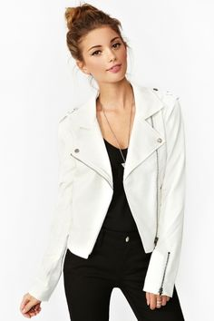 The perfect white vegan leather moto jacket featuring side pockets and zipped cuffs. Button tab at shoulder, asymmetric zip closure. Fully lined. Looks killer tossed over a body-con dress with platform boots!