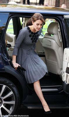 Thrifty Kate strikes again! Duchess of Cambridge shows no signs of her late night as she stuns in a recycled Orla Kiely dress onvisit to a child mentoring programme | Daily Mail Online
