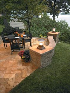Define an area in your landscape with a retaining wall. Add seating, a patio, or an outdoor fireplace or grill.  Shown- Bayfield freestanding wall by Basalite