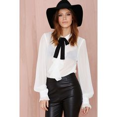 The Poetic License Blouse is made in sheer white chiffon and features ruffle det…