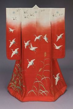 Kimono (uchikake)  Japanese, Meiji era, late 19th century, Silk plain-weave crepe (kabe-chirimen); hand drawn paste resist-dyed and painted (yûzen), embroidered, Outer robe (uchikake) with long sleeves and padded hem and design of flying cranes (tsuru) and autumn grass (susuki) embroidered, printed and handpainted in white, gray, black, green and brown on a predominantly red ground with white across the shoulders suggesting sunset (akebono). MFA