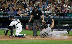 New York Yankees' Mark Teixeira (25) scores on a sacrifice fly hit by Aaron…