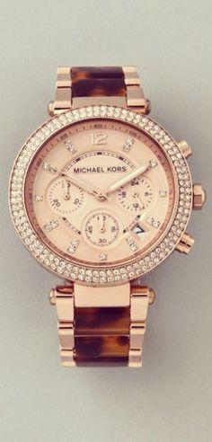 Yo encanto el reloj. El reloj cuesta doscientos setenta y cinco dólares.
