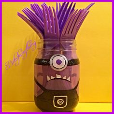 DIY- I painted a Purple minion Mason jar for a minion theme birthday party. I used purple forks from party city for the hair