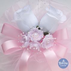 Detail of silk flowers pew bow with silk pink ribbon for wedding.