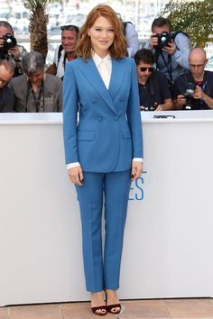 Lea Seydoux wore head-to-toe Prada, opting for a double-breasted suit and maroon heels.