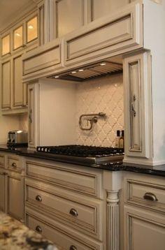 Suzie: M. E. Beck Design - Antique ivory kitchen cabinets with polished granite black ...