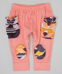 Take a look at this Squeeky Knees Salmon & Black Tribal Squeaker Harem Pants - Infant on zulily today!