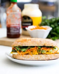 This vegetarian banh mi sandwich features egg on a chewy baguette, topped with pickled vegetables and doused in mayo and hot sauce. Veggie Recipes, Vegetarian Recipes, Dinner Recipes, Healthy Recipes, Dinner Ideas, Meal Ideas, Quick Recipes, Lunch Ideas, Asian Recipes