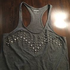 Express studded razorback grey tank top Perfect for a night out or day shopping.. Super comfy and LIKE NEW, worn only a couple of times, studded/embellished, size XS, razor back tank top, covers the girls and is a looser fit on bottom.. Can send measurements/ additional photos upon request! Express Tops Tank Tops