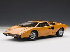 This Lamborghini Countach Diecast Model Car is Orange and features working steering, suspension, wheels and also opening bonnet, boot with engine, doors. It is made by AUTOart and is scale (approx. Lamborghini Models, Lamborghini Veneno, Camaro Zl1, Chevrolet Camaro, Car Roof Box, S Wallpaper Hd, Autoart Diecast, Mercedes Benz Sls Amg, Autos
