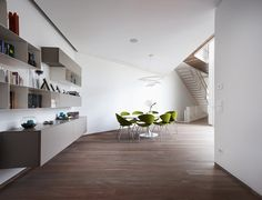 Amazing Dining Space Design In Bergamo Residence Dap Studio With Light Brown Wooden Floor And Several Green Back Chairs