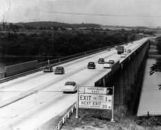 The Turnpike's original Susquehanna River Bridge, facing eastbound towards Steelton, in the 1950s.  Notice the old style guide sign complete with a US 230 shield.