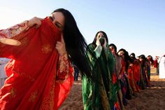 """Sweihan, UAE - Women perform a traditional Bedouin dance, the """"hair dance"""" before the camel race at the Sweihan cultural festival. (image by Nicole Hill) Belly Dancer Costumes, Belly Dancers, Dance Costumes, Middle East Culture, Half The Sky, Belly Dancing Classes, Red Colour Palette, Shall We Dance, Dance Fashion"""
