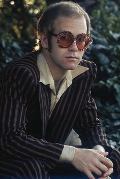 Elton John was knighted in 1998 for his public service and philanthropy; and now he is known as Sir Elton John. Big Music, I Love Music, Punk, Captain Fantastic, Music Icon, Glam Rock, My Favorite Music, Rock Style, Rock Music