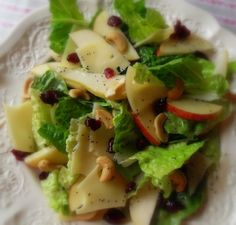 Winter Fruit Salad..A perfect blend of crunchy romaine lettuce, sweet apples, pears and cranberries, salty cashew nuts and nutty emmenthal cheese, swathed in a tangy lemon and poppy seed dressing. Delicious!!