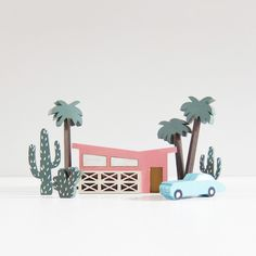 The Mini City by McKean Studio!  A miniature model of one of our all-time favourite cities, Palm Springs. A  mid-century heaven in the Californian desert, USA - we've loved the cactus,  the palm trees, the cute cars, and the incredible architecture.  Now you can own a little piece for your own home! The perfect gift for the  constant daydreamer, the mid-century design addict, or even just the  notoriously hard to buy for!  Comprised of 7 pieces, this miniature model set can be arranged and…