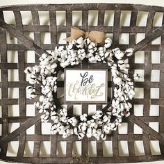 """Our preserved cotton wreath adds farmhouse charm to any room. Wired for easy shaping. Available in two sizes Small: 22"""" dia Large: 26"""" dia"""