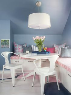 HGTV has a teen's dream room with a window seat with custom pink cushions, graphic multicolor pillows, white regency table, white pendant light and cool chairs. Attic Bedroom Small, Attic Rooms, Attic Spaces, Girls Bedroom, Attic Playroom, Bedroom Ideas, Attic Library, Attic House, Attic Office