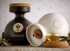 Ladolea Organic E. This clay Olive Oil bottles are inspired by the shape and material of bottles which were used by the Olympic athletes 700 B. The designers Spytos Kyzis and Leandros. Olive Oil Packaging, Greek Olives, Red Dot Design, Graphic Design, Olive Oil Bottles, Unique Recipes, Dinner Table, Packaging Design, Place Card Holders