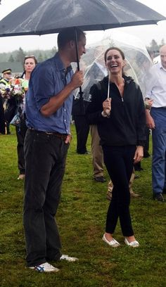 Britains Prince William and his wife Catherine the Duchess of Cambridge walk in the rain in Dalvay-by-the Sea, Prince Edward Island July 4, 2011.