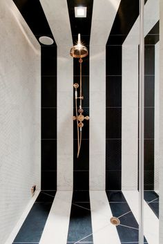 Black and white stripes in bathroom shower