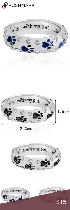 """🆕 (E24) Blue Paw Print Ring Rings are white gold plated with crystal gems. On the inside of the ring it says """"when I'm with my pet I'm complete""""  Sizes are 6, 7, and 8. I have all red, blue and black. Each have their own listing. Jewelry Rings"""