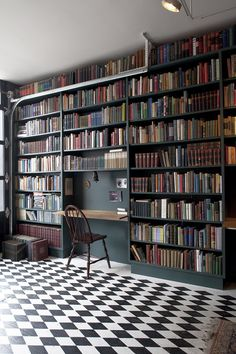 Grey bookshelves make the books really stand out Custom Shelving in the library of the Oracle Club.
