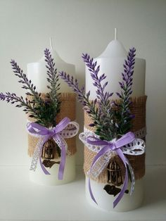 A solidarity candle is basically a candle used in a marriage experience to symbolize two people signing up with in relationship.White candles with lavender, burlap and ribbon bow, spring wedding decors see lots and lots of hand crafted, classic, as w Christmas Candle Decorations, Spring Wedding Decorations, Christmas Candles, Wedding Centerpieces, Christmas Crafts, Lavender Centerpieces, Candle Centerpieces, White Candles, Diy Candles