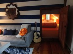 Blue and White Stripes, orange and white attic bedroom, Urban Outfitters sofa, duvet, rug