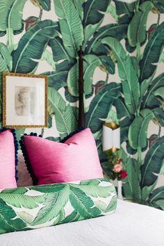 Palm leaf wallpaper. Pink pillows. Navy pom trim. Pink and green. Bedroom.  Interior Design // Austin Bean Design Studio. Photography // Alyssa Rosenheck.  Featured // Rue Magazine