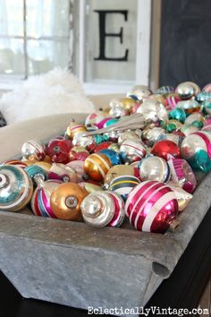 Vintage Shiny Brite ornament display - love them filling a huge zinc trough eclecticallyvintage.com