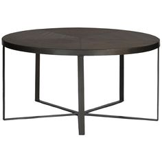 Sometimes, there's no need to reinvent the wheel. For the Michael Coffee Table we left well enough alone, playing off industrial, minimalist design with this round coffee table, which sits on an iron base. 34 by 34 inches, the table is 17 inches tall.  Materials Mindy top and Iron base  Finish Waxed Mindy & Dark Gunmetal
