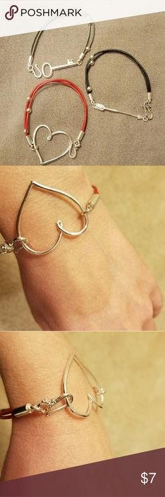 Bundle of three bracelets Heart, arrow and key cute bracelets with leather band and hook closure. Costume jewelry. Fits smaller wrist. Arrow bracelet has some of the silver coating missing from the hook (see last picture). Jewelry Bracelets