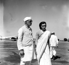 Mrs Indira Gandhi with Pandit Jawaharlal Nehru Prime Minister of India photographed at Palam Aerodrome on October 3, 1949, before her departure for London.