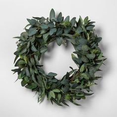 Hearth & Hand with Magnolia Eucalyptus Wreath. Bring a bit of greenery into your dwelling with this Eucalyptus Wreath from Hearth & Hand with Magnolia. Adding a fresh element to your space. Eucalyptus Wreath, Seeded Eucalyptus, Eucalyptus Leaves, Indoor Wreath, Magnolia Wreath, Chip And Joanna Gaines, Potted Trees, Wooden Picture Frames, Circle Shape