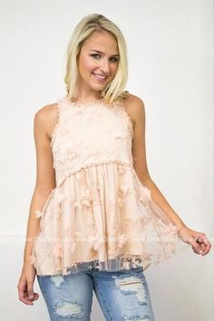 How DARLING is this 3D peach top. I'm in love with the sparkles and lace. This sleeveless top features a scoop neck, a babydoll fit, a 3D floral print, and lace