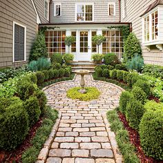 Atlanta Cottage Garden | This all-green cottage garden is kept interesting by varying the hues from light to bright | SouthernLiving.com