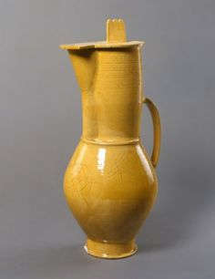 Otto Lindig, Tall lidded pot with scored decoration, 1922 High-fired stoneware, freely turned and mounted, yellow transparent glaze