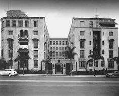 "https://flic.kr/p/qhFYsA | The Los Altos Apartments, 4121 Wilshire Boulevard, ca.1936 | The Los Altos Apartments at 4121 Wilshire Boulevard, built in 1926 by Edward B. Rust and Luther Mayo in a Mission Revival style, was originally developed as a ""co-op"", but went bankrupt during the Depression. They are still with us today.  LAPL"