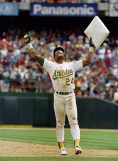 May 1991 - Oakland Athletics outfielder Rickey Henderson steals his base to break Lou Brock& record for stolen bases in a career. Henderson stole a total of bases in his major league career, almost 500 more than the next closest player. Cheap Baseball Caps, Baseball Games, Sports Baseball, Baseball Players, Baseball Field, Baseball Records, Basketball Rules, Baseball Uniforms, Baseball Stuff