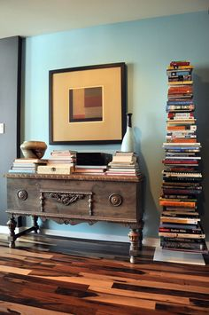 A book tower something I could never maintain in my home unless they had a steel rod running through the center and were bolted to the floor. My Living Room, Living Spaces, Modern Condo, Three Bedroom House, Stack Of Books, Book Nooks, Reading Nooks, Interiores Design, Apartment Therapy