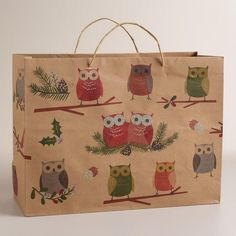 With colorful owls printed on Kraft paper, our exclusive subtly glittered gift bag adds festive whimsy to your holiday gifts.