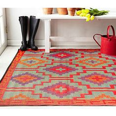 This beautifully crafted Haza INDOOR/OUTDOOR rug will add a splash of moroccan style and color to your home - via DTLL.