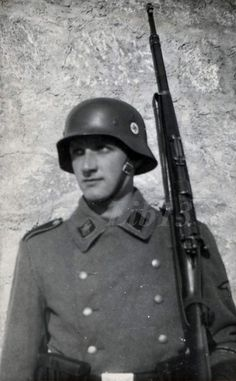 SS guard and his K98 rifle.