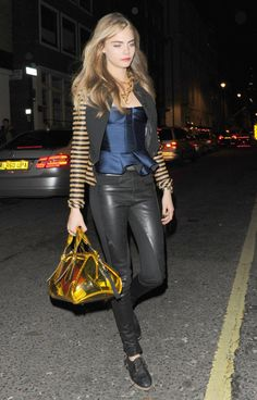 Cara Delevingne StyleChi Black Part Leather Trousers Shiny Blue Peplum Top Striped Jacket Lace Up Shoes Grey Maxi Skirts, Maxi Skirt Outfits, Fashion News, Fashion Models, Models Style, Harry Styles Birthday, Cara Delevingne Style, Leather Jeans, Victoria Secret Fashion