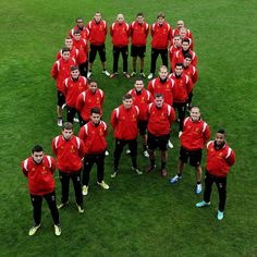 Liverpool FC players form a red ribbon in support of World Aids Day