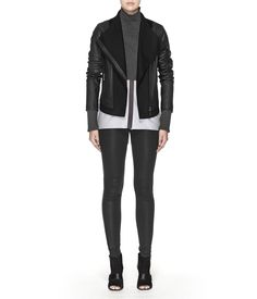 Our Courtney is a true original.  Premium leather on the sleeves and on the sides and back of the bodice evokes a cropped jacket left open, while felted wool on the folded, triangulating collar; down the center of the bodice; and along the hem, suggests a warm sweater underneath.  Fully lined with a side zip closure and two side zip pockets